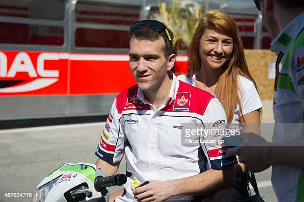 Xavier Simeon of Belgium and Federal Oil Gresini Moto2 looks on in paddock with the girlfriend before the preevent 'MotoGP riders visit Bodegas Jos...