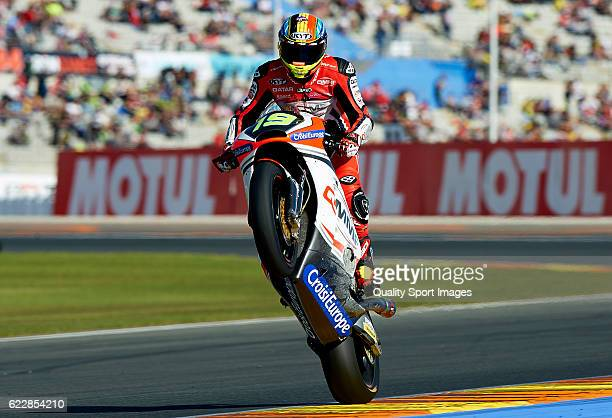 Xavier Simeon of Belgium and QMMF Racing Team lifts the front wheel during the MotoGP of Valencia Qualifying at Comunitat Valenciana Ricardo Tormo...