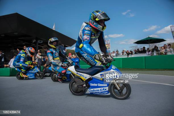 Xavier Simeon of Belgium and Reale Avintia Racing rides the minimoto and leads the field during the preevent 'Minimotos Traditional Challenge' during...
