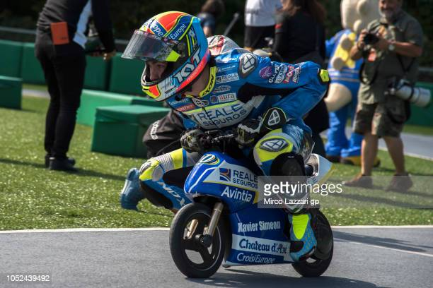 Xavier Simeon of Belgium and Reale Avintia Racing rides the minimoto during the preevent 'Minimotos Traditional Challenge' during the MotoGP of Japan...