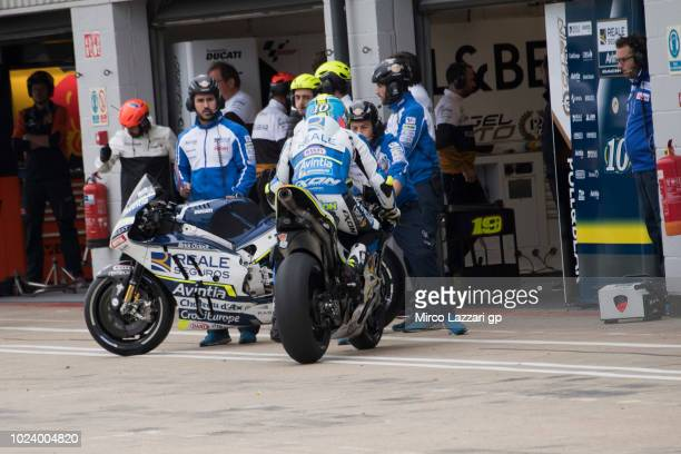 Xavier Simeon of Belgium and Reale Avintia Racing tests the change bikes during the wurmup during the MotoGp Of Great Britain Race at Silverstone...