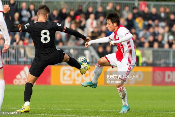Xavier Simons of FC Chelsea U19 and Filip Frei of Ajax Amsterdam U19 battle for the ball during the UEFA Youth League match between AFC Ajax and...