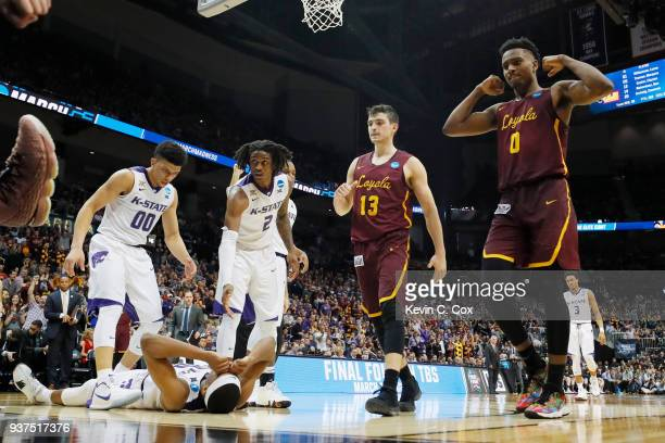 Xavier Sneed is helped up by Mike McGuirl and Cartier Diarra of the Kansas State Wildcats as Clayton Custer and Donte Ingram of the Loyola Ramblers...