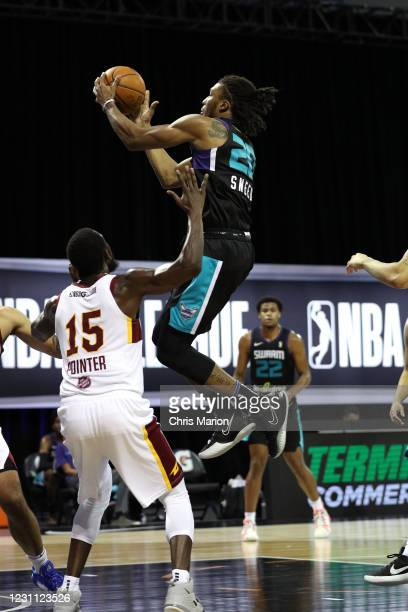 Xavier Sneed of the Greensboro Swarm shoots the ball against the Canton Charge on February 12, 2021 at HP Field House in Orlando, Florida. NOTE TO...