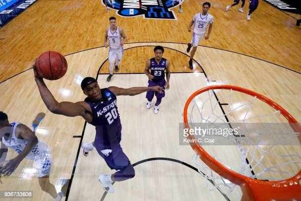 Xavier Sneed of the Kansas State Wildcats attempts to dunk the ball against the Kentucky Wildcats in the first half during the 2018 NCAA Men's...