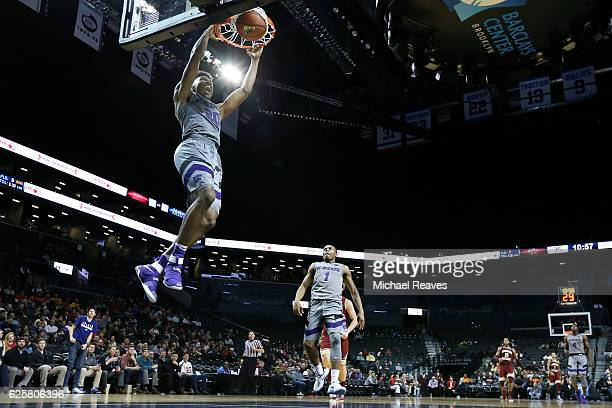 Xavier Sneed of the Kansas State Wildcats celebrates as he slams home a dunk against the Boston College Eagles in the second half during the Barclays...
