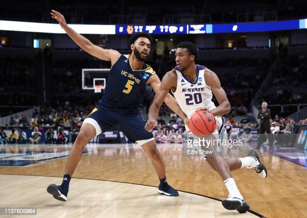 Xavier Sneed of the Kansas State Wildcats dribbles the ball past Jonathan Galloway of the UC Irvine Anteaters in the first half during the first...