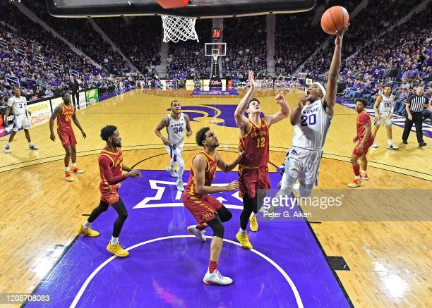 Xavier Sneed of the Kansas State Wildcats drives and scores a basket against Michael Jacobson of the Iowa State Cyclones during the first half at...