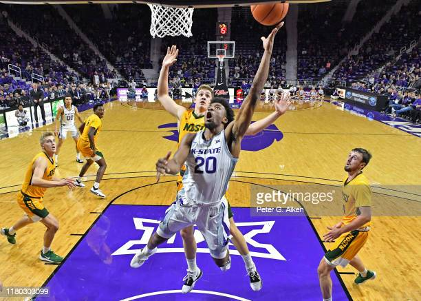 Xavier Sneed of the Kansas State Wildcats drives in for a basket against Rocky Kreuser of the North Dakota State Bison during the first half on...