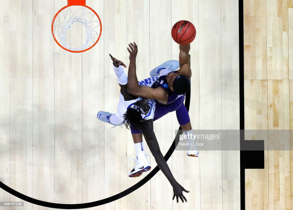 Xavier Sneed #20 of the Kansas State Wildcats drives to the basket against Wenyen Gabriel #32 of the Kentucky Wildcats in the first half during the 2018 NCAA Men's Basketball Tournament South Regional at Philips Arena on March 22, 2018 in Atlanta, Georgia.