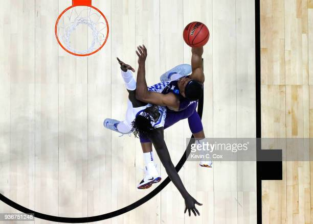 Xavier Sneed of the Kansas State Wildcats drives to the basket against Wenyen Gabriel of the Kentucky Wildcats in the first half during the 2018 NCAA...