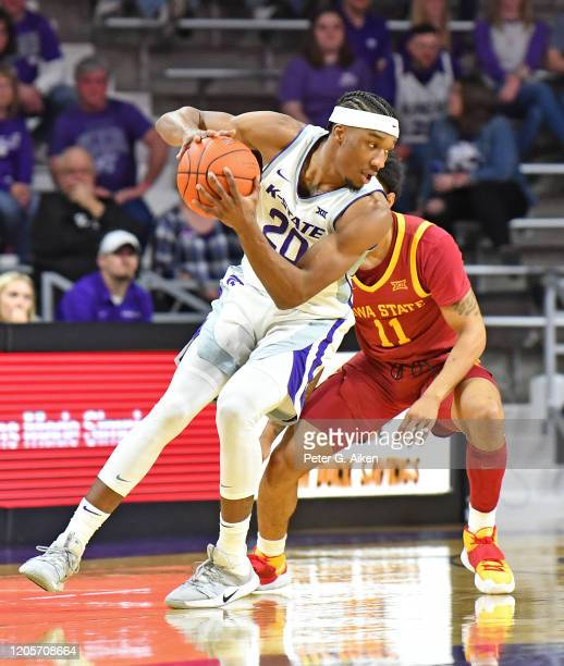 Xavier Sneed of the Kansas State Wildcats drives with the ball against Prentiss Nixon of the Iowa State Cyclones during the first half at Bramlage...