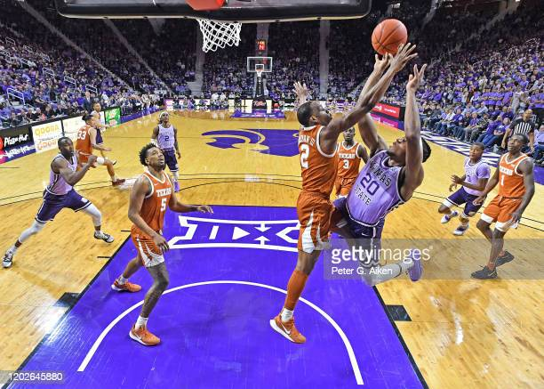 Xavier Sneed of the Kansas State Wildcats puts up a shot against pressure from Matt Coleman III of the Texas Longhorns during the first half at...