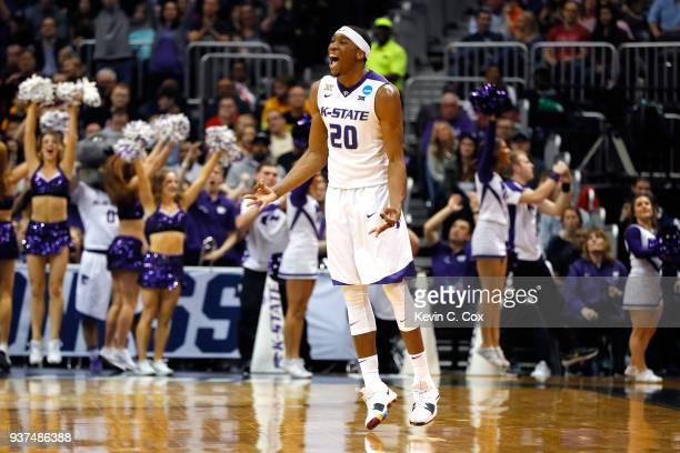 Xavier Sneed of the Kansas State Wildcats reacts after a play in the first half against the Loyola Ramblers during the 2018 NCAA Men's Basketball...