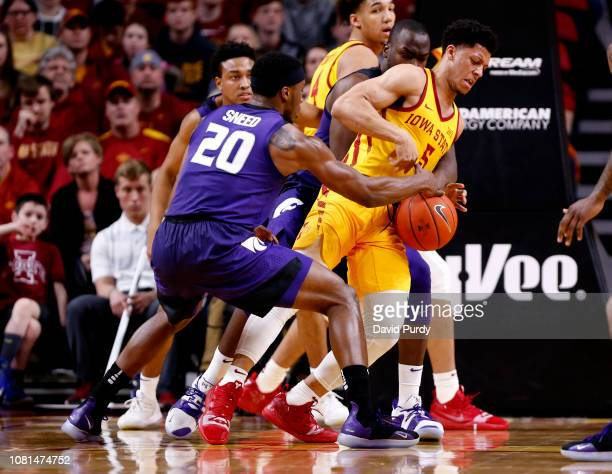 Xavier Sneed of the Kansas State Wildcats strips the ball away from Lindell Wigginton of the Iowa State Cyclones under the basket in the second half...