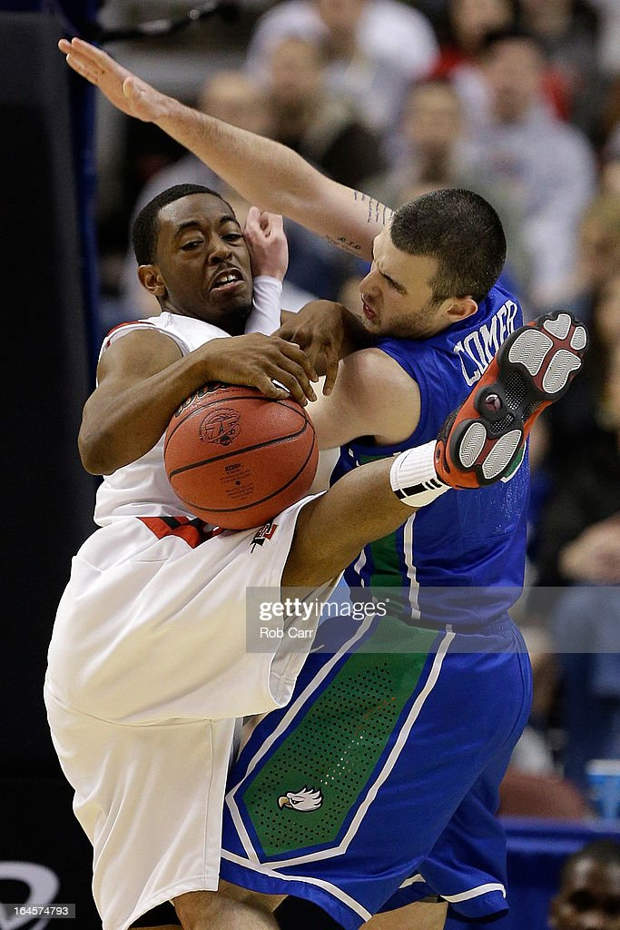 Xavier Thames #2 of the San Diego State Aztecs and Brett Comer #0 of the Florida Gulf Coast Eagles battle for the ball in the second half during the third round of the 2013 NCAA Men's Basketball Tournament at Wells Fargo Center on March 24, 2013 in Philadelphia, Pennsylvania.