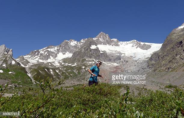 Xavier Thevenard of France who won the Ultra Trail 2013 race runs on a trail in the mountains near Chamonix and the MontBlanc in the French Alps...
