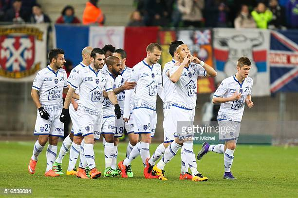 Xavier Thiago of Troyes jubilate with teammate after scoring the first goal during the French Ligue 1 match between SM Caen and ESTAC Troyes at Stade...
