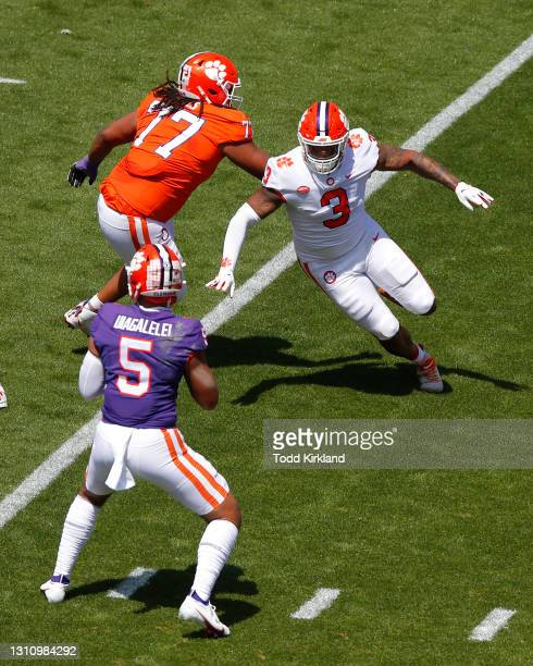 Xavier Thomas of the Clemson Tigers pressures D.J. Uiagalelei during the Clemson Orange and White Spring Game at Memorial Stadium on April 3, 2021 in...