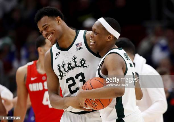 Xavier Tillman and Cassius Winston of the Michigan State Spartans celebrate after beating the Ohio State Buckeyes 77-70 during the quarterfinals of...