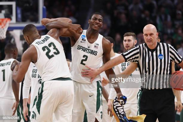 Xavier Tillman and Jaren Jackson Jr. #2 of the Michigan State Spartans celebrate during the second half against the Bucknell Bison in the first round...
