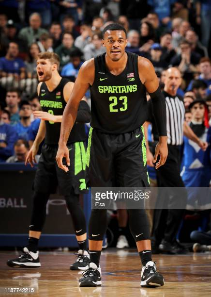 Xavier Tillman and Kyle Ahrens of the Michigan State Spartans celebrate in the first half against the Seton Hall Pirates at Prudential Center on...