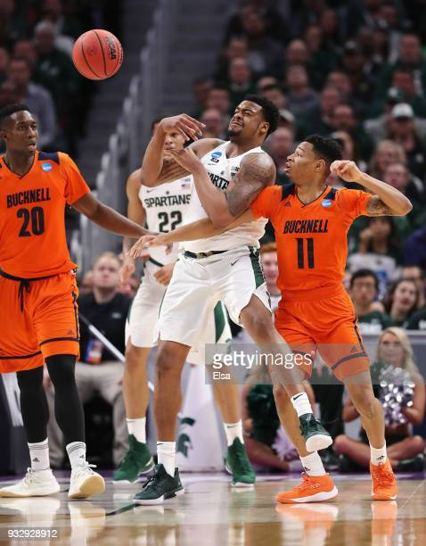 Xavier Tillman of the Michigan State Spartans and Avi Toomer of the Bucknell Bison battle for a rebound during the first half in the first round of...
