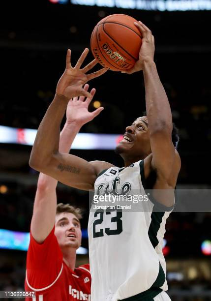 Xavier Tillman of the Michigan State Spartans attempts a shot while being guarded by Nate Reuvers of the Wisconsin Badgers in the second half during...