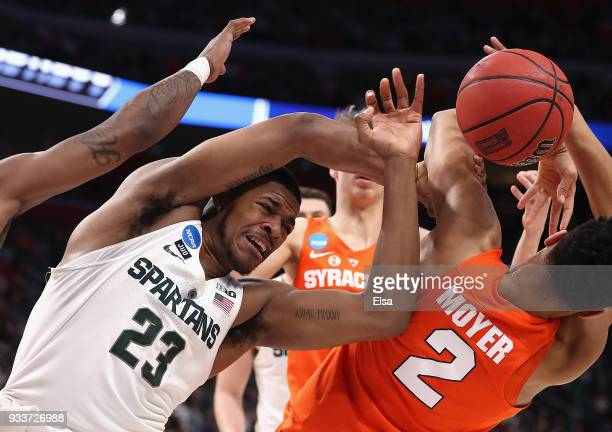 Xavier Tillman of the Michigan State Spartans battles for a rebound with Matthew Moyer of the Syracuse Orange during the first half in the second...