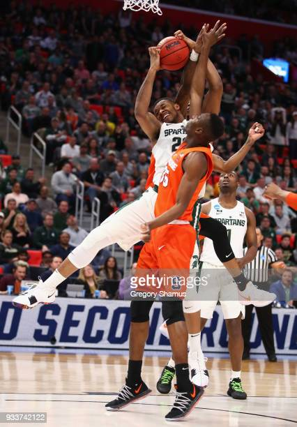 Xavier Tillman of the Michigan State Spartans battles for the ball with Bourama Sidibe of the Syracuse Orange during the second half in the second...