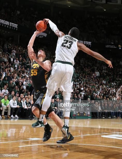 Xavier Tillman of the Michigan State Spartans blocks the shot of Luka Garza of the Iowa Hawkeyes in the second half of the game at the Breslin Center...