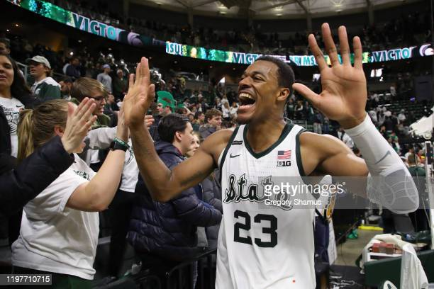 Xavier Tillman of the Michigan State Spartans celebrates a 87-69 win over the Michigan Wolverines with fans at the Breslin Center on January 05, 2020...