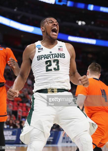 Xavier Tillman of the Michigan State Spartans celebrates after dunking the ball during the first half against the Bucknell Bison in the first round...