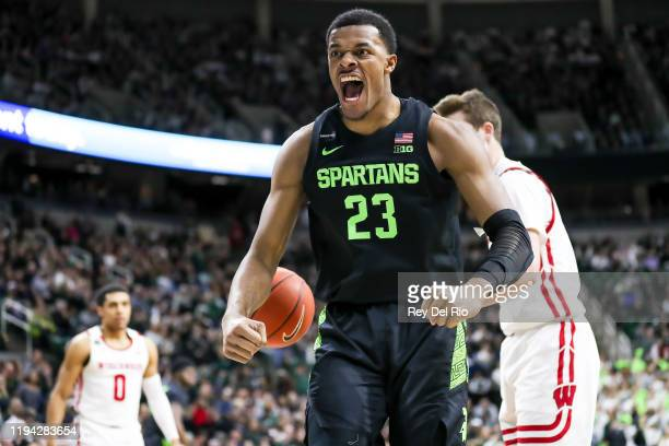 Xavier Tillman of the Michigan State Spartans celebrates his made basket in the first half of the game against the Wisconsin Badgers at the Breslin...