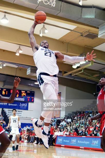 Xavier Tillman of the Michigan State Spartans drives to the basket during a second round Maui Invitation game against the Georgia Bulldogs at the...