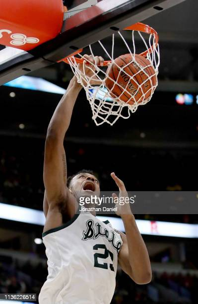 Xavier Tillman of the Michigan State Spartans dunks the ball in the second half against the Wisconsin Badgers during the semifinals of the Big Ten...