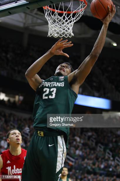Xavier Tillman of the Michigan State Spartans gets to the basket past Amir Harris of the Nebraska Cornhuskers during the first half at Breslin Center...
