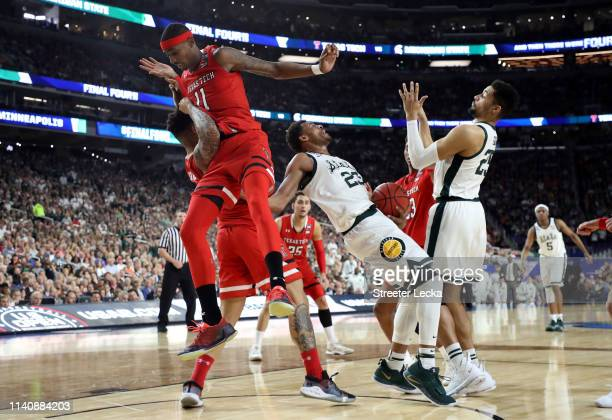 Xavier Tillman of the Michigan State Spartans handles the ball against Tariq Owens of the Texas Tech Red Raiders in the first half during the 2019...