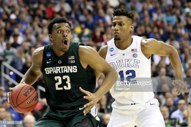 Xavier Tillman of the Michigan State Spartans is defended by Javin DeLaurier of the Duke Blue Devils during the second half in the East Regional game...