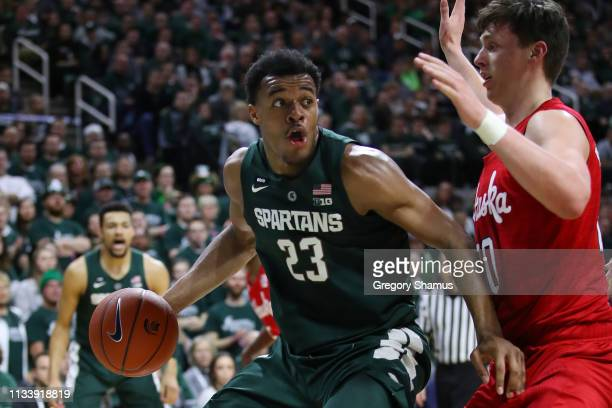 Xavier Tillman of the Michigan State Spartans looks to drive around Tanner Borchardt of the Nebraska Cornhuskers during the first half at Breslin...