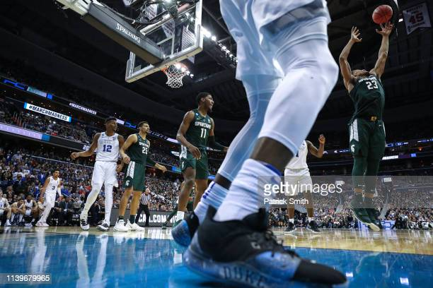 Xavier Tillman of the Michigan State Spartans pulls in a rebound against the Duke Blue Devils in the East Regional game of the 2019 NCAA Men's...