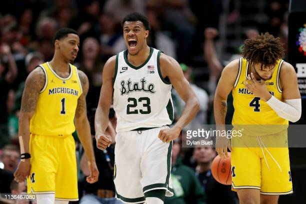 Xavier Tillman of the Michigan State Spartans reacts in the second half against the Michigan Wolverines during the championship game of the Big Ten...