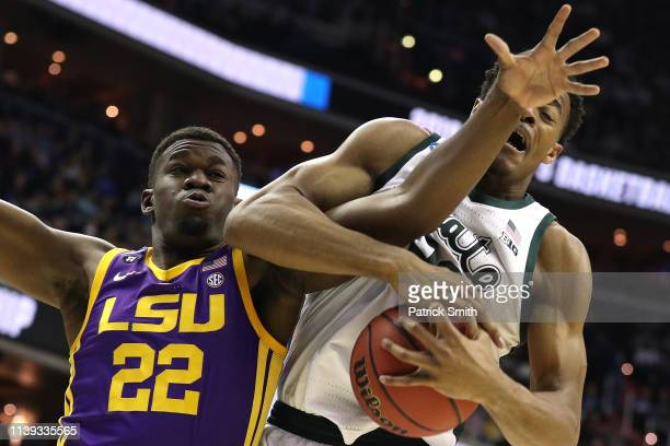 Xavier Tillman of the Michigan State Spartans rebounds against Darius Days of the LSU Tigers during the first half in the East Regional game of the...