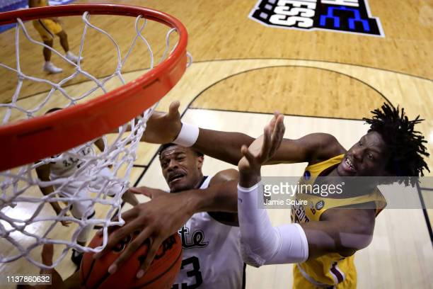Xavier Tillman of the Michigan State Spartans rebounds against Gabe Kalscheur of the Minnesota Golden Gophers during the second half in the second...