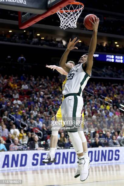 Xavier Tillman of the Michigan State Spartans shoots the ball against the Minnesota Golden Gophers during the first half in the second round game of...