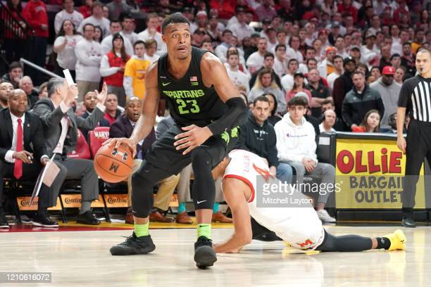 Xavier Tillman Sr. #23 of the Michigan State Spartans dribbles the ball during a college basketball game against the Maryland Terrapins at the...