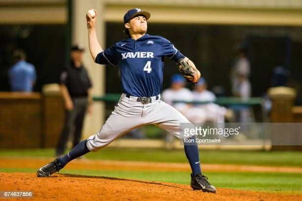 Xavier University infielder/right handed pitcher Conor Grammes gives it his all during a regular season college baseball game between the Xavier...