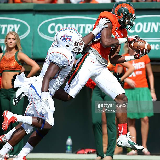 Xavier Williams of the Colorado State Rams makes a touchdown pass reception against K'Lon Lovett of the Savannah State Tigers in the second quarter...
