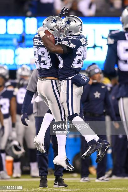 Xavier Woods is congratulated by Darian Thompson of the Dallas Cowboys after his interception during the second quarter of the game against the New...