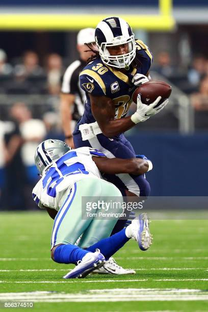 Xavier Woods of the Dallas Cowboys hits Todd Gurley of the Los Angeles Rams as he turns to carry the ball after a reception in the second half of a...